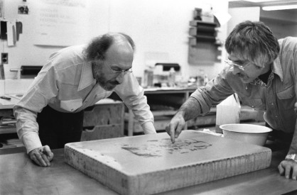 Richard Hamilton and Kenneth Tyler studying inked lithographic stone for the artist's 'Flower Piece B, crayon study', Tyler Graphics Ltd., Bedford Village, New York, 1976