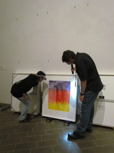 Conservation staff inspecting Jasper Johns 'Color numerals' series