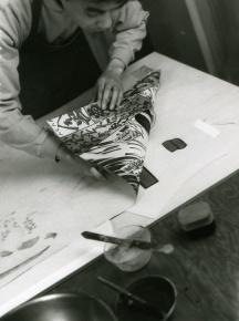 Using Ukiyo-e technique, Yasuyuki Shibata prints colour woodblock areas of Masami Teraoka's 'Kunisada Eclipsed' from 'Hawaii Snorkel Series' woodblock, Tyler Graphics Ltd paper mill, Mount Kisco, New York, 1993 Photo: Jim McHugh