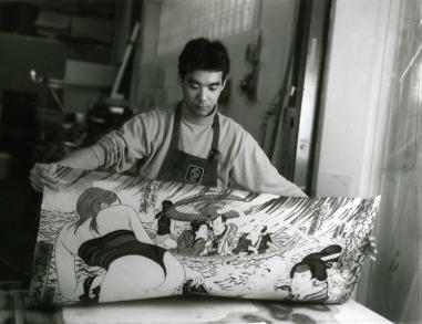 Yasuyuki Shibata removing newly printed impression of Masami Teraoka's 'Kunisada Eclipsed' from 'Hawaii Snorkel Series' woodblock, Tyler Graphics paper mill, Mount Kisco, New York, 1993 Photo: Jim McHugh