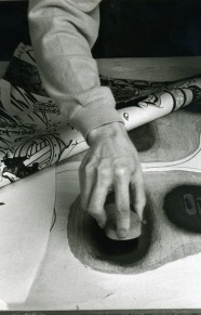 Yasuyuki Shibata moistening relief areas of carved woodblock for Masami Teraoka's 'Kunisada Eclipsed' from 'Hawaii Snorkel Series' with a brush prior to inking, Tyler Graphics paper mill, Mount Kisco, New York, 1993 Photo: Jim McHugh