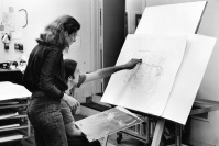 Rodney Konopaki comparing with Nancy Graves one of her newly printed proofs to the intaglio plate, Tyler Graphics Ltd. artist's studio, Bedford Village, New York, 1977