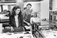 Nancy Graves consulting with Rodney Konopaki as she mixes inks for her intaglio prints, Tyler Graphics Ltd. workshop, Bedford Village, New York, 1977