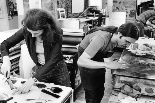 Nancy Graves mixes inks while Rodney Konopaki wipes copper intaglio plate in preparation for printing an impression, Tyler Graphics Ltd. workshop, Bedford Village, New York, 1977