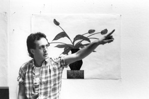 Ed Baynard pictured in front of his 15 colour woodblock print 'The Blue Tulips', Tyler Graphics Ltd. artist's studio, Bedford Village, New York, 1980. Photo: Lindsay Green