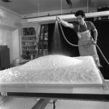 Tom Strianese hosing down protruding area of pulp on newly vacuum formed shaped paper pulp for one of Frank Stella's 'Moby Dick Domes' series papers, Tyler Graphics paper mill, Mount Kisco, New York, 1991. Photo: Steven Sloman