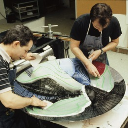 Mark Mahaffey and Tom de Bolt applying ink to shaped magnesium plate for 'The Funeral (Dome)' for Frank Stella's 'Moby Dick Domes' series, Tyler Graphics Ltd., Mount Kisco, New York, 1988. Photo: Marabeth Cohen-Tyler