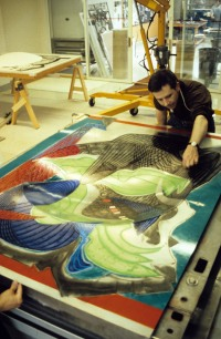 Tom de Bolt adjusting dome printing element on 'The Funeral (Dome)' magnesium assembled plates on press bed of hydraulic platen press for Frank Stella's 'Moby Dick Domes' series, Tyler Graphics paper mill, Mount Kisco, New York, May 1988. Photo: Marabeth Cohen-Tyler