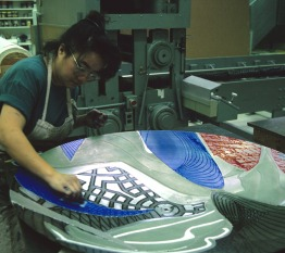 Kathy Cho inking one of the shaped magnesium printing elements for 'The Funeral (Dome)' work from Frank Stella's 'Moby Dick Domes' series, Tyler Graphics workshop, Mount Kisco, New York, February 1990. Photo: Marabeth Cohen-Tyler