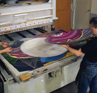 Anthony Kirk positioning shaped magnesium printing element for 'Stubb & Flask kill a Right Whale (Dome)' from Frank Stella's 'Moby Dick Domes' series to flat magnesium printing element, both in 'female' section of two-part printing mould on hydraulic platen press bed, Tyler Graphics paper mill, Mount Kisco, New York, March 1991. Photo: Steven Sloman