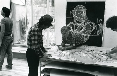 Kenneth Tyler and Bob Cross carve a woodblock in preparation for magnesium plate to be inserted for Frank Stella's 'Pergusa three', from the 'Circuits' series, Tyler Graphics Ltd., Bedford Village, New York, 1981. Photo: Lindsay Green. National Gallery of Australia, Canberra