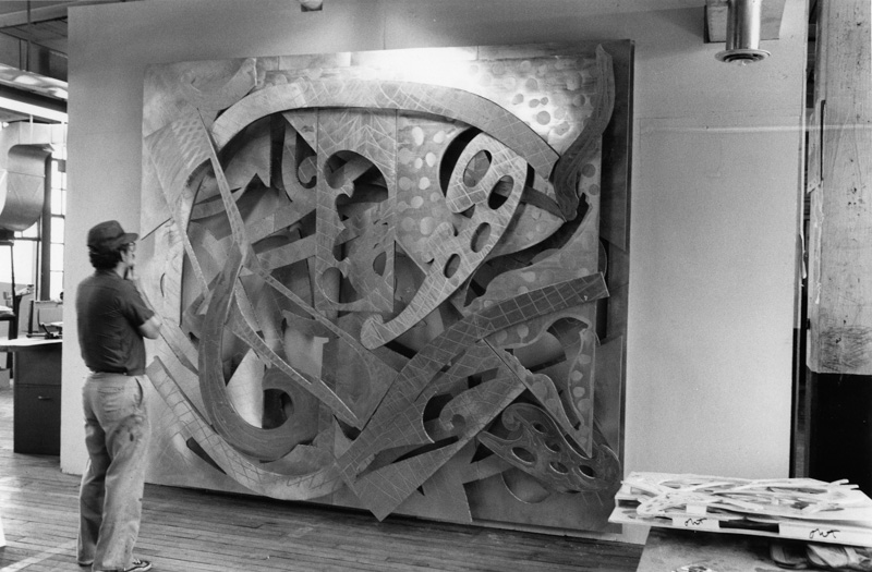 Frank Stella views 'Mosport' from his 'Circuits' series of relief paintings (in progress) on the wall of his studio, Bridgeport Connecticut, June 1982