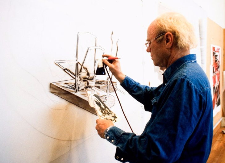 James Rosenquist air brushing mylar for lithography collage element for 'Skull snap' from his 'Welcome to the water planet' series, Tyler Graphics Ltd., Mount Kisco, New York, 1989