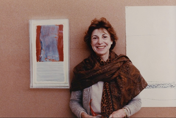 Helen Frankenthaler standing next to framed print of 'Essence Mulberry'